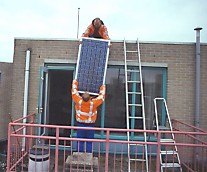 transporting solar panels and ballast  from terrace to flat roof